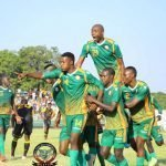 Players celebrate after Green Eagles batters Power